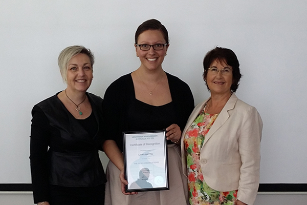 Liana Mattia receiving her certificate for the completion of The Performance Edge course.
