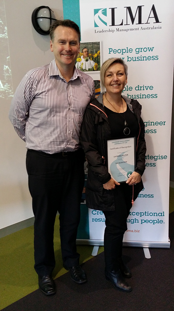 Catriona Dolphin receiving her certificate for the completion of The Sales Edge course.
